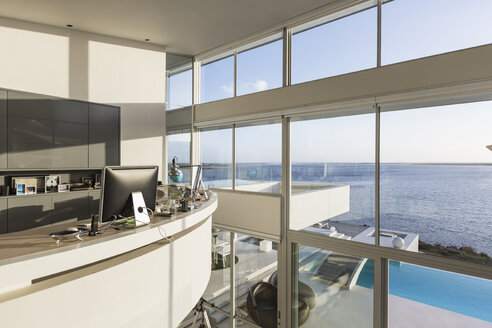 Modern luxury home showcase interior home office with sunny ocean view - HOXF02167