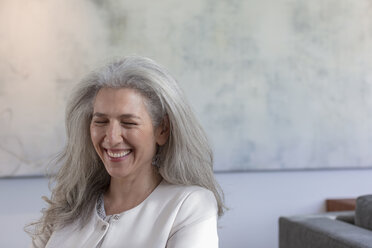 Mature woman laughing with eyes closed - HOXF02356