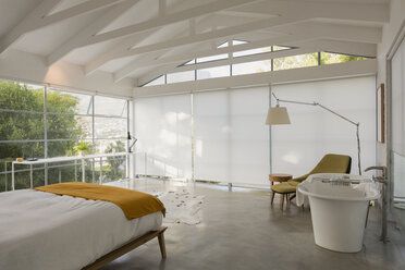 Modern, minimalist home showcase interior bedroom with vaulted ceiling - HOXF02413
