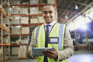 Portrait confident manager with digital tablet in distribution warehouse - HOXF02467