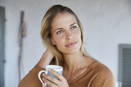 Serene woman drinking coffee - HOXF02626