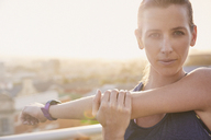Close up portrait determined female runner stretching arms - HOXF02725