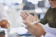 Hands of businessman gesturing in meeting - HOXF02962