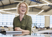 Laughing businesswoman in office - HOXF02980