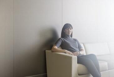 Portrait confident businesswoman on sofa - HOXF03286