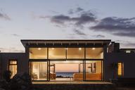 Illuminated luxury home under sky at dusk - HOXF03301