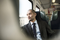 Thoughtful businessman traveling in train - CAVF00427