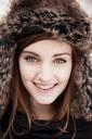 Close-up portrait of happy woman wearing fur hat - CAVF00739