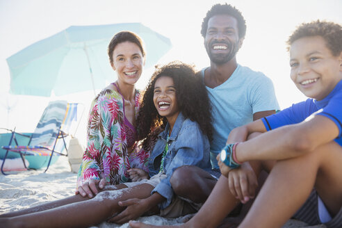 Portrait smiling, happy multi-ethnic family on summer beach - CAIF04779