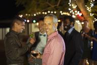 Man smiling at party - CAIF04882