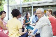Man smiling at party - CAIF04894