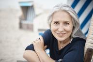 Portrait smiling senior woman on beach - CAIF05169