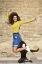 Happy young woman jumping in the air - JSMF00073