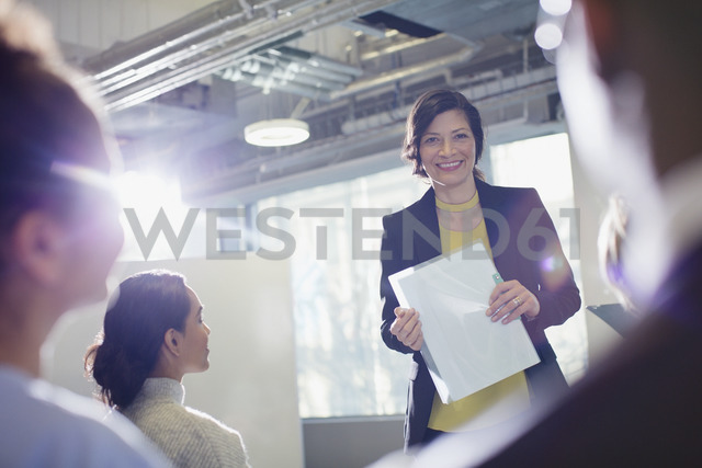Portrait smiling businesswoman leading meeting in office - CAIF05670