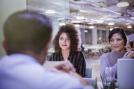 Businesswomen listening in conference room meeting - CAIF05688