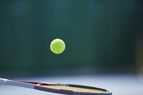 Tennis ball bouncing on tennis racket - CAIF05829