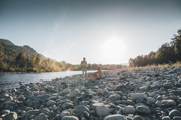 Canada, British Columbia, Chilliwack, two men resting at Fraser River - GUSF00405