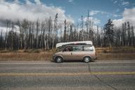 Canada, British Columbia, man with minivan on Alaska Highway - GUSF00441