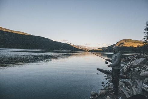 Canada, British Columbia, man fishing at Kinbasket Lake - GUSF00447