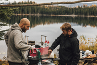Canada, British Columbia, two men cooking at Blue Lake - GUSF00492