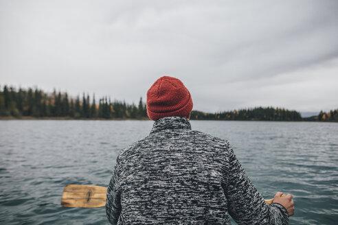 Canada, British Columbia, man in canoe on Boya Lake - GUSF00507