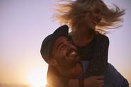 Playful couple piggybacking - CAIF05871