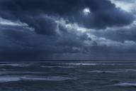 Dark clouds in overcast sky over stormy ocean, Devon, United Kingdom - CAIF05913