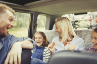 Playful family laughing and singing in car - CAIF06093