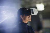 Businesswoman using virtual reality simulator - CAIF06162