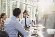Business people talking in office meeting - CAIF06234