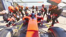 Pit crew replacing tires on formula one race car in pit lane - CAIF06458