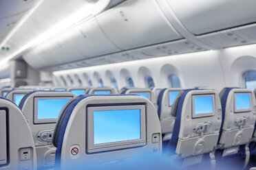 Entertainment screens on seats in airplane - CAIF06590