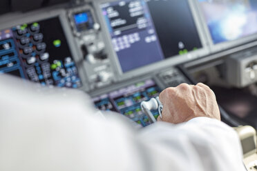 Pilot flying airplane in cockpit - CAIF06599