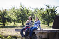 Family with daughter sitting on abandoned trailer - CAVF01281