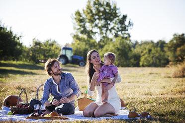 Family enjoying picnic on sunny day - CAVF01287