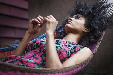 Thoughtful woman relaxing on hammock - CAVF01314