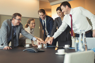 Business people playing team building exercise with glass in conference room - CAIF06632