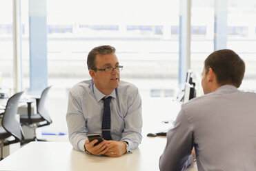 Businessmen talking in office - CAIF06722
