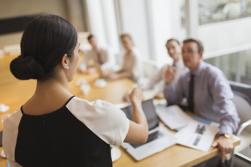 Businesswoman leading meeting in conference room - CAIF06737