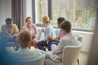 Women talking in group therapy session - CAIF06860
