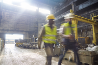 Steelworkers walking in steel mill - CAIF06911