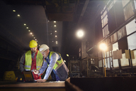 Steelworkers using laptop in steel mill - CAIF06920