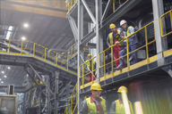 Steelworkers talking on platform in steel mill - CAIF06941