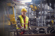 Portrait serious, confident steelworker in steel mill - CAIF06971