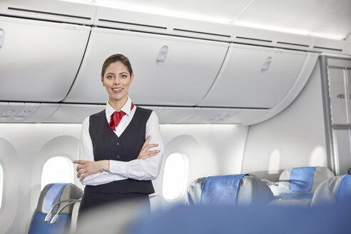 Portrait smiling, confident female flight attendant on airplane - CAIF07022