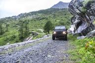 France, Rhone-Alpes, Savoie, Landrover on gravel road - MMAF00290