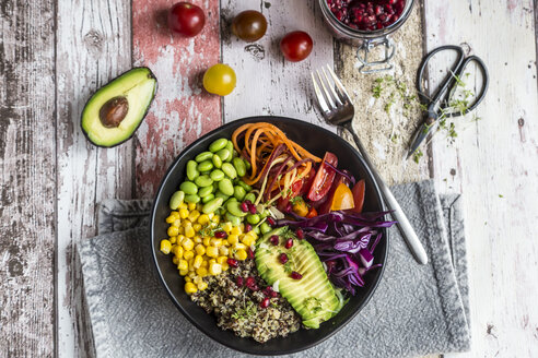 Quinoa veggie bowl of avocado, Edamame, tomatoes, corn, carrots, red cabbage and pomegranate seed - SARF03592