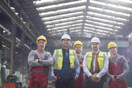 Portrait confident engineers and workers in factory - CAIF07274