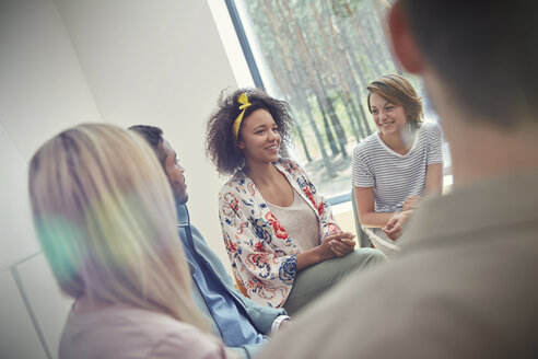 Woman talking in group therapy session - CAIF07493