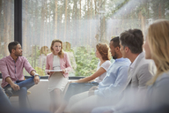 Therapist leading group therapy session - CAIF07496